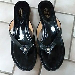 Coach black patent leather sandals.